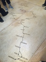 northern and southern routes of the Iditarod trail embedded into the floor of the yurt